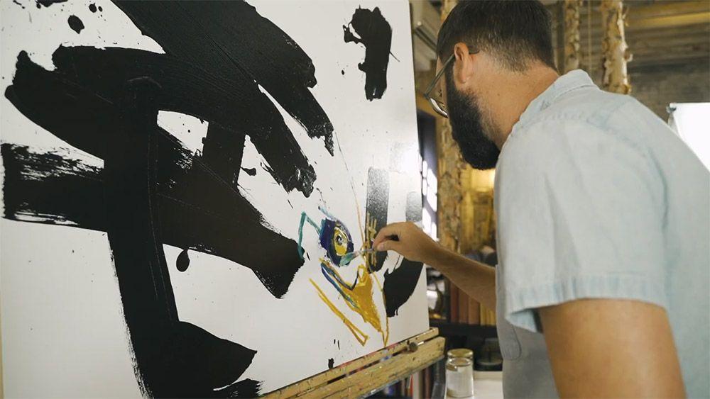 Daniel McClendon starts a painting