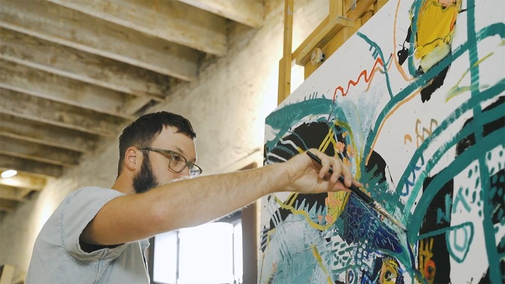 Daniel McClendon works on a painting in progress